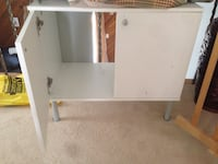 white wooden 4-footed cabinet