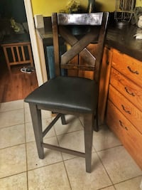 Three Counter height chairs