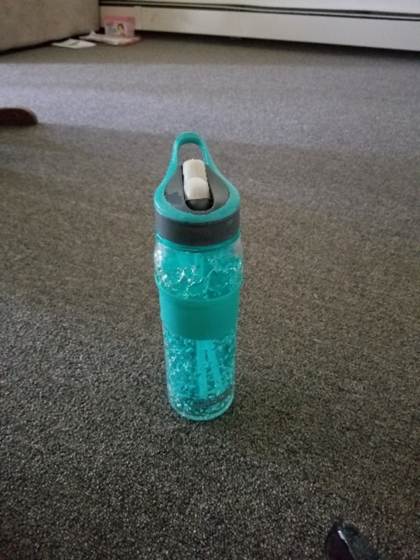 teal and white plastic bottle