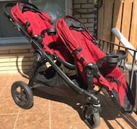 baby's red and black jogging stroller TORONTO