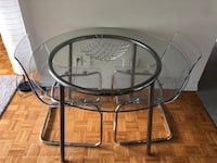 Round clear glass top table with black metal base Oshawa, L1L 7W1