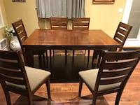 Dining room table with adjustable size and 6 cushion chairs. Vancouver, V6A 1X9