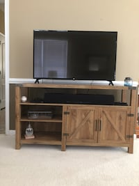 flat screen television with brown wooden TV stand Purcellville, 20132