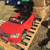 Kid's black and red car ride on toy