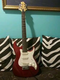 red and white stratocaster electric guitar 28 km