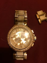Gold and stainless steel micheal kors watch with extra clasp
