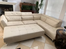 Faux leather sectional with ottoman.