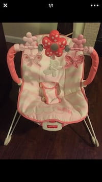 baby's white and pink Fisher-Price bouncer