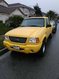yellow Ford F-150 single-cab pickup truck