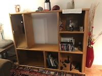 brown wooden TV hutch with flat screen television Arlington