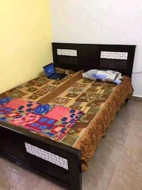 brown wooden bed frame with mattress Bengaluru, 560099
