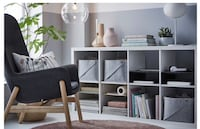 black and gray wooden TV stand 787 km
