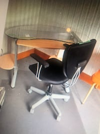 Glass top office desk with swivel chair