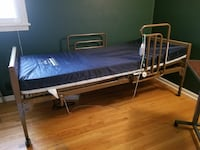 gray and blue semi-electric bed frame