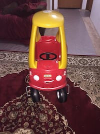 red and yellow Little Tikes cozy coupe Ranson