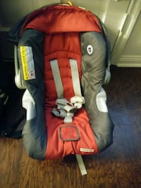 baby's red and gray car seat carrier Houston, 77092