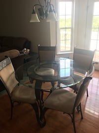 Round glass top table with four chairs dining set Manassas, 20110