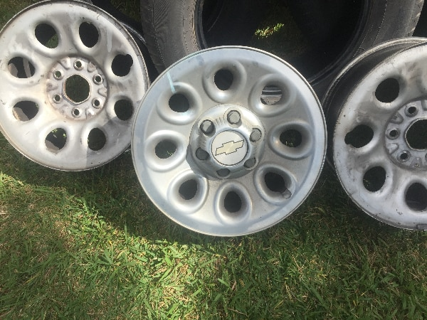Photo Chevy 17 inch. FOUR- OEM Truck Rims ONLY