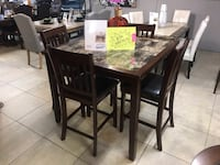 rectangular brown wooden table with six chairs dining set Houston, 77041