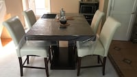 2 month old dining set. Bought for $800. Selling for $550. No defects completely new product.
