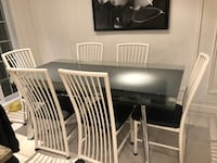 Beautiful glass/chrome table with 6 chairs  Laval, H7G
