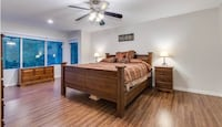 Bedroom furniture (king bed, dresser, two night tables, two bedside lamps, and storage trunk)