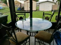 round glass-top table with chairs Clewiston, 33440