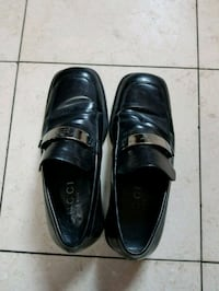 pair of black leather dress shoes Secaucus, 07094