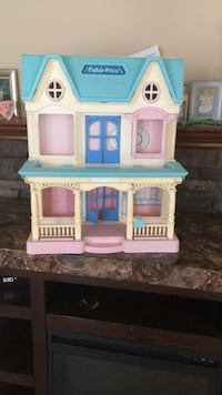 Beige, teal and pink Fisher Price dollhouse Sanford, 27332