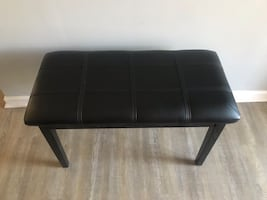 Black leather piano bench