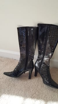 Pair of black leather knee high boots Arlington, 22206