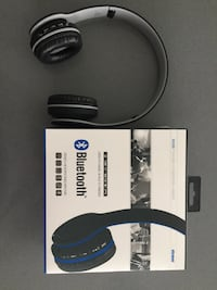 gray and black cordless headphones with box Longueuil, J3Y