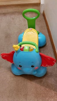blue and yellow Fisher-Price ride on toy