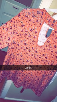 orange, purple, and white floral long-sleeved shirt