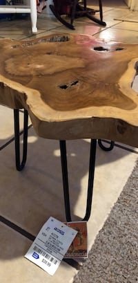 brown wooden side table with black metal base