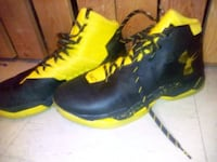 pair of black-and-yellow Nike basketball shoes Victoria