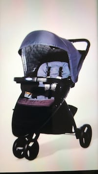 Baby's black and purple stroller