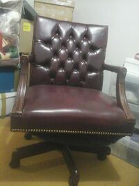 black leather padded rolling armchair Calgary, T1Y