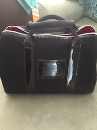 black and gray duffel bag 513 km
