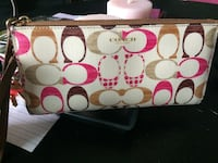 White, brown, and pink Coach wristlet