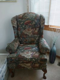 Upholstered high back accent chair.
