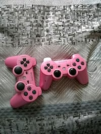 two pink and purple Sony PS3 controllers Ellenwood, 30294