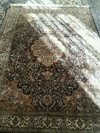brown and black floral area rug Ashburn, 20148