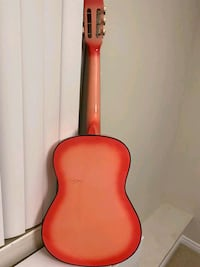 A pink guitar with learning tow learning books