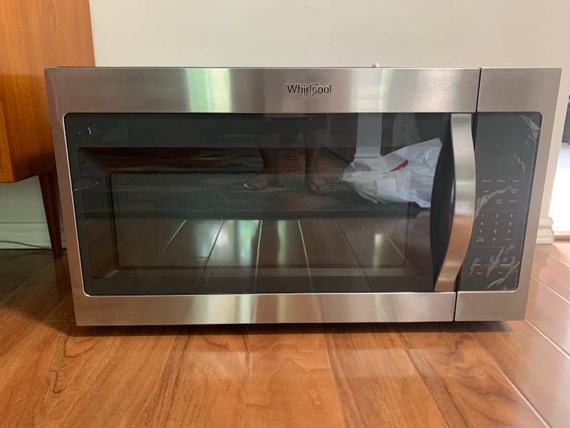 Whirlpool over the range microwave, stainless steel. fa77f774-3b51-423d-acc0-5c57dc1d4aff