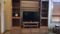 Brown wooden tv hutch with flat screen television Edwardsburg, 49112