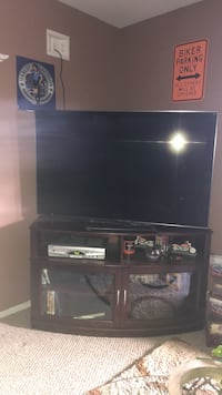 Television and cherry wood stand