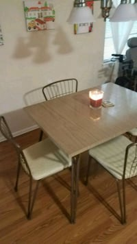 rectangular brown wooden table with four chairs di Lakewood Township, 08701