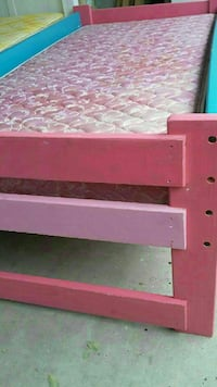 pink quilted mattress pink wooden bed frame
