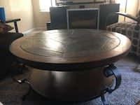 Round brown wooden coffee table Kansas City, 64132